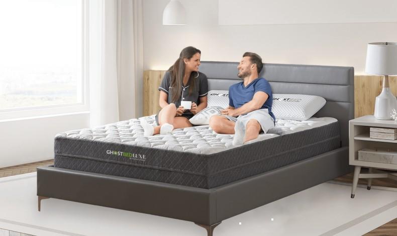 Couple relaxing on a queen size mattress